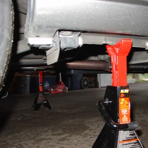 Jack Stands only go this way. Never put them on plastic!